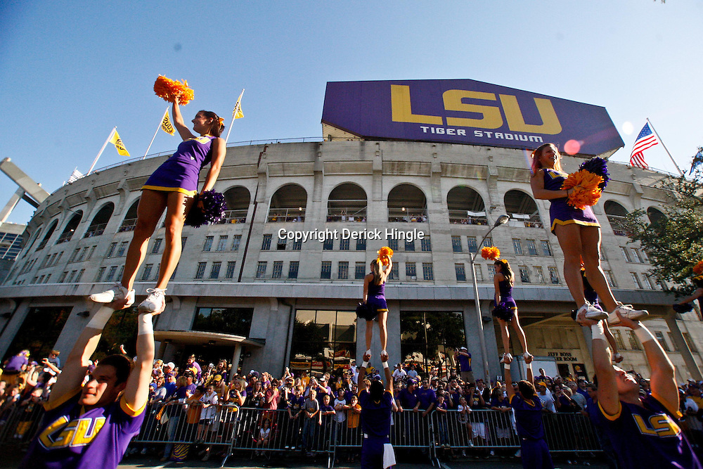 October 16, 2010; Baton Rouge, LA, USA; LSU Tigers cheerleaders perform outside prior to kickoff of a game between the LSU Tigers and the McNeese State Cowboys at Tiger Stadium.  Mandatory Credit: Derick E. Hingle