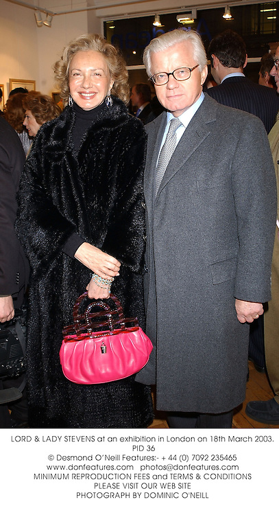 LORD &amp; LADY STEVENS at an exhibition in London on 18th March 2003.<br />