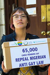 London, September 30th 2015. LGBT protesters demonstrate outside the Nigerian High Commission in London  demanding the repeal of the country's anti-LGBT laws, handing over a petition with over 65,000 signatures demanding that President Muhammadu Buhari  upholds LGBTI human rights. PICTURED: over 65,000 signatures have been added to a petition supporting LGBTI rights in Nigeria.