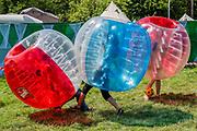Football in inflatable balls in the circus field - The 2019 Glastonbury Festival, Worthy Farm. Glastonbury, 27 June 2019