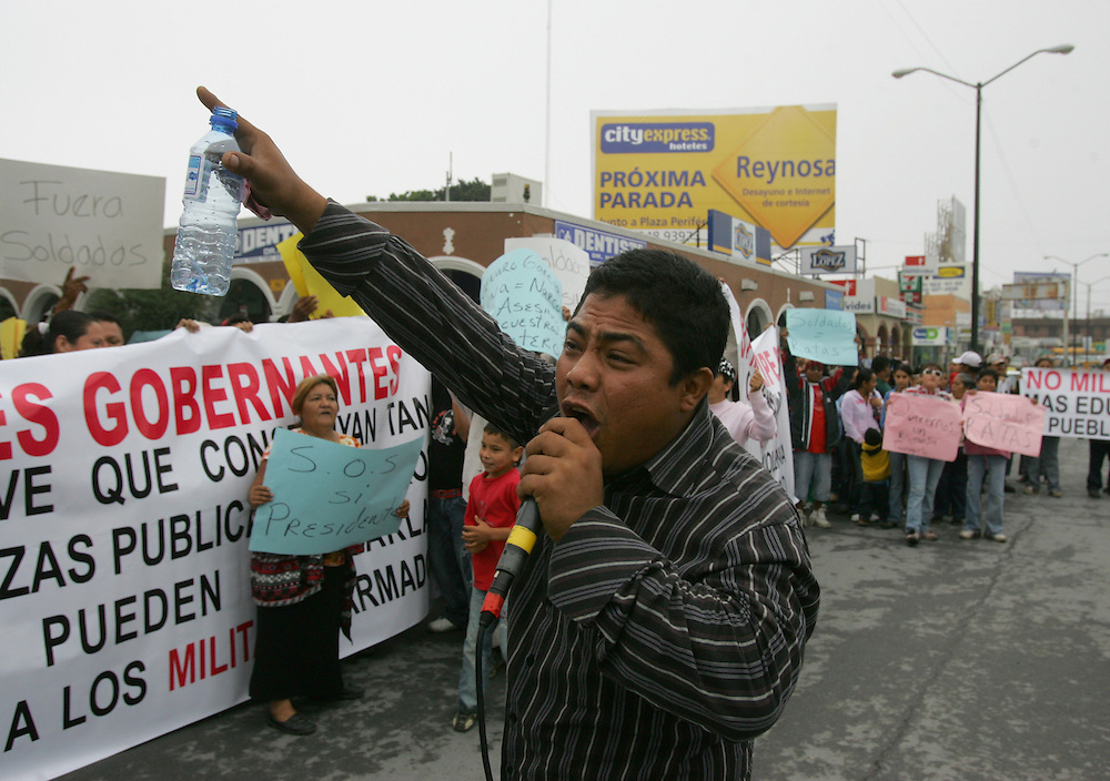 Reynosa, Tamaulipas - 17 Feb 2009 - .A protestor leads a chant calling for Mexican soldiers to leave during a protest that blocked the Hidalgo International Bridge in Reynosa on Tuesday morning..Photo by Alex Jones / ajones@themonitor.com