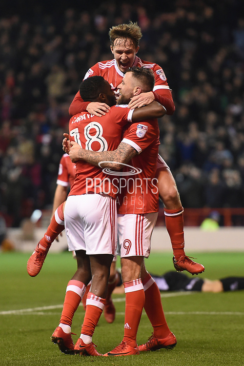 Nottingham Forest midfielder Kieran Dowell (20), Nottingham Forest midfielder Mustafa Carayol (18) and Nottingham Forest forward Daryl Murphy (9) celebrates after scoring a goal to make it 1-0 during the EFL Sky Bet Championship match between Nottingham Forest and Norwich City at the City Ground, Nottingham, England on 21 November 2017. Photo by Jon Hobley.