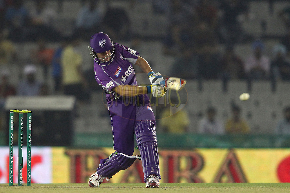 Evan Gulbis of the Hobart Hurricanes hits over the top during match 2 of the Oppo Champions League Twenty20 between the Kings XI Punjab and the Hobart Hurricanes held at the Punjab Cricket Association Stadium, Mohali, India on the 18th September 2014<br /> <br /> Photo by:  Shaun Roy / Sportzpics/ CLT20<br /> <br /> <br /> Image use is subject to the terms and conditions as laid out by the BCCI/ CLT20.  The terms and conditions can be downloaded here:<br /> <br /> http://sportzpics.photoshelter.com/gallery/CLT20-Image-Terms-and-Conditions-2014/G0000IfNJn535VPU/C0000QhhKadWcjYs