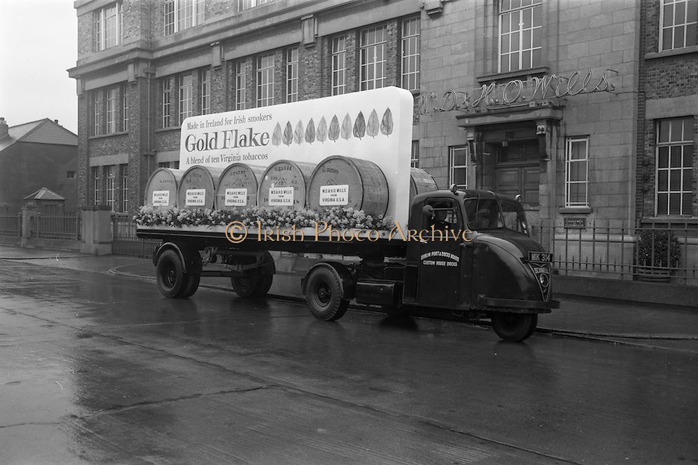 17/03/1965<br /> 03/17/1965<br /> 17 March 1965<br /> NAIDA St. Patrick's Day Parade, Dublin. W. D.& H. O. Wills float for the parade parked outside the Wills Tobacco factory on South Circular Road, the truck is a Dublin Port and Docks Scammmel Scarab.