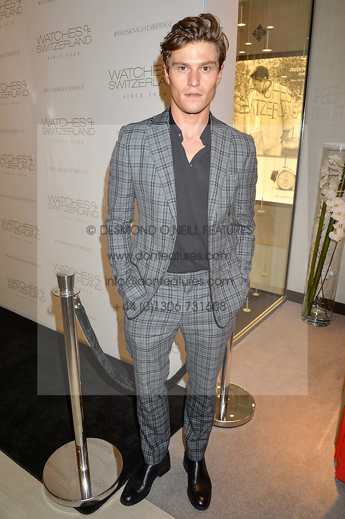 OLIVER CHESHIRE at a party to celebrate the launch of the new Watches of Switzerland Knightsbridge store 47-51 Brompton Road, London on 7th July 2016.