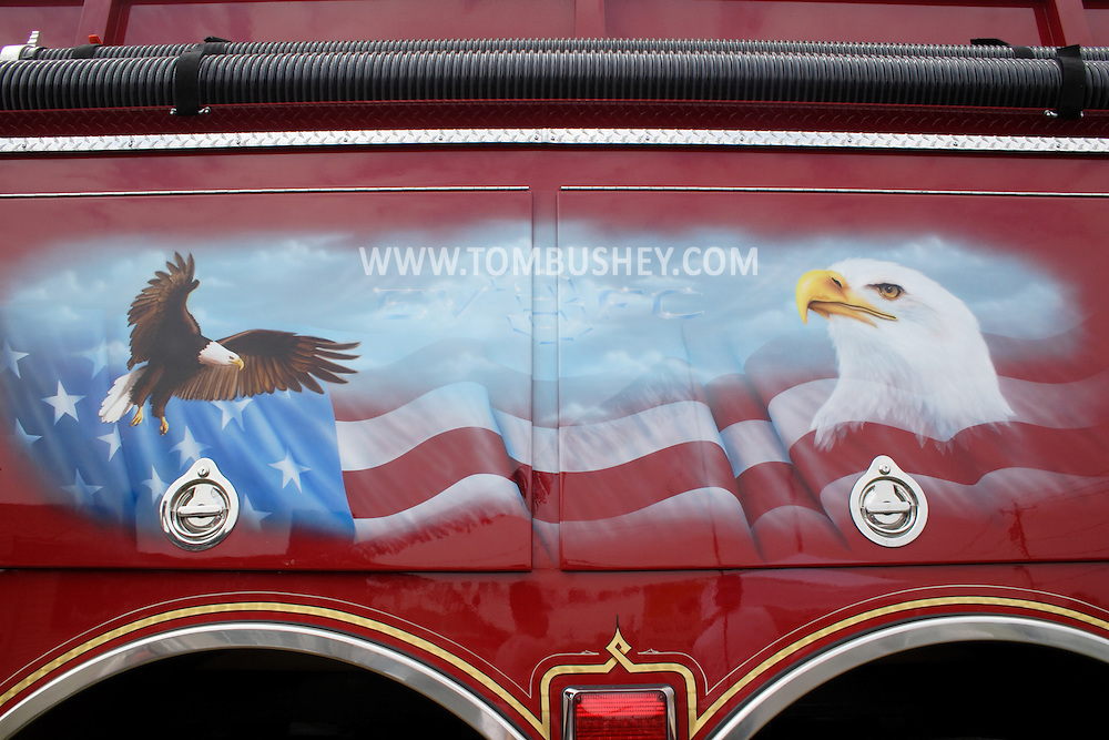 A fire truck from Eagle Valley Fire Company No. 3 was on display at Hot Air Graphixx, the company that airbrushed the artwork on the side of the truck, during the shop's grand opening on Aug. 19, 2006. ©Tom Bushey