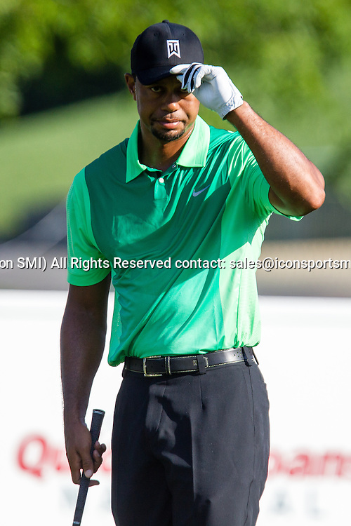 June 26, 2014: Tiger Woods acknowledges the crowd around the tee box prior to starting his first round of the Quicken Loans National at Congressional Country Club in Bethesda, MD.