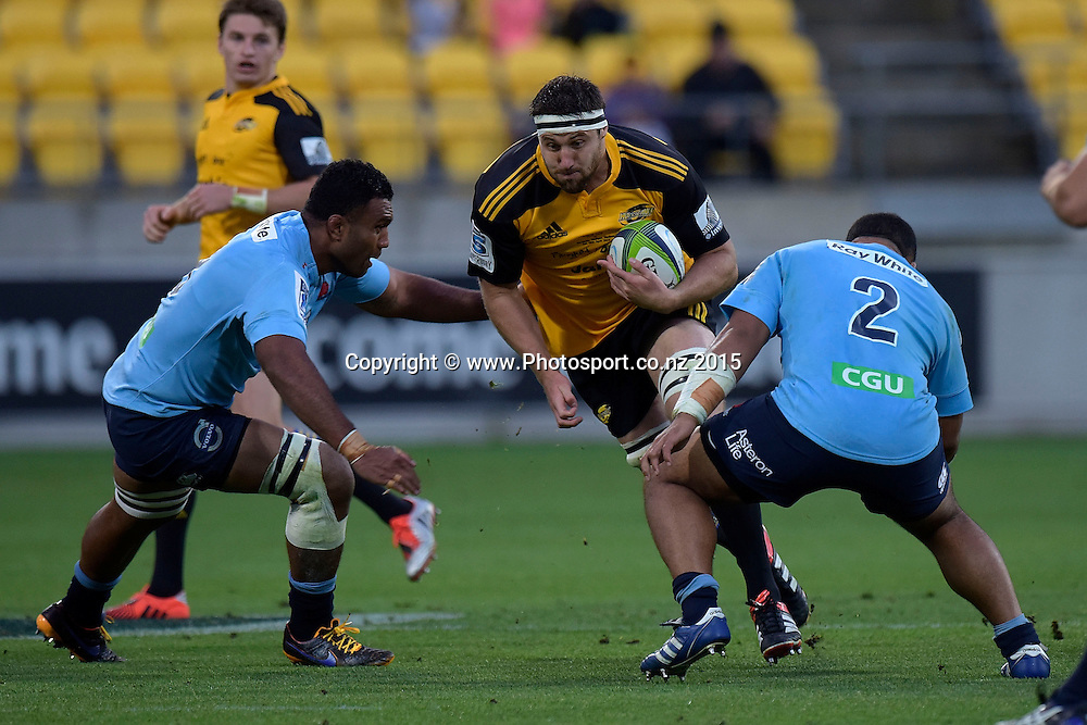 Hurricanes' lock Jeremy Thrush (C is tackled by Waratahs' Wycliff Palu (L) and Tolu Latu during the Super Rugby - Hurricanes v Waratahs rugby union match at the Westpac Stadium in Wellington on Saturday the 18th of April 2015. Photo by Marty Melville / www.Photosport.co.nz
