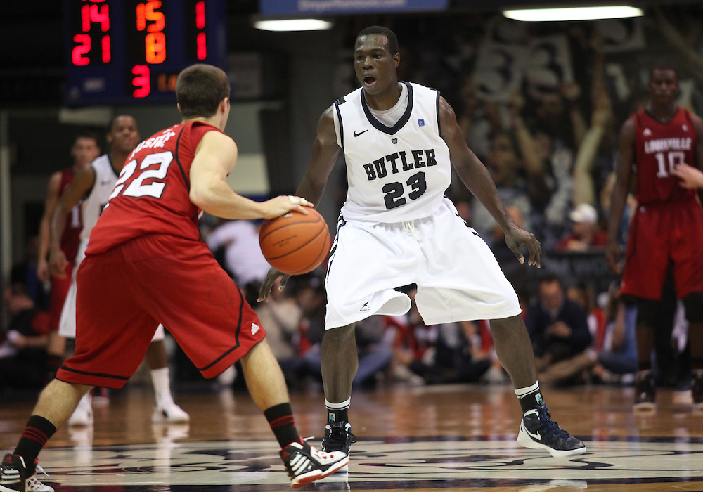 November 19, 2011: Butler's Khyle Marshall keeps his eye on Louisville's Elisha Justice during the second half of the game at Hinkle Fieldhouse in Indianapolis, Ind. Louisville won 69-53.