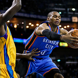 December 10, 2010; New Orleans, LA, USA; Oklahoma City Thunder guard Russell Westbrook (0) loses the ball as New Orleans Hornets center Emeka Okafor (50) defends the play during the first half at the New Orleans Arena.  Mandatory Credit: Derick E. Hingle-US PRESSWIRE