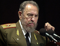 Cuban President Fidel Castro, addresses to the nation in occasion of the 45th Anniversary of the revolutionary triumph, in a political act celebrated at the Karl Marx theatre on Saturday January 3, 2004, in Havana, Cuba. (Photo/Cristobal Herrera)
