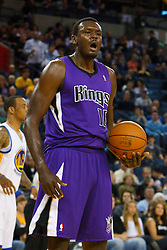 April 10, 2011; Oakland, CA, USA;  Sacramento Kings center Samuel Dalembert (10) celebrates after a play against the Golden State Warriors during the first quarter at Oracle Arena.