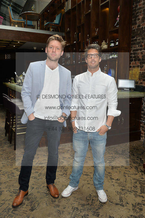 Left to right, NICK THAIN CEO of GiveMeSport and JAE CHALFIN founder of GiveMeSport at the launch of Give Me Sport Magazine held at Library, 112 St.Martin's Lane, London on 30th July 2014.