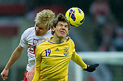 (L) Daniel Lukasik of Poland fights for the ball with (R) Denys Harmasz of Ukraine during the 2014 World Cup Qualifying Group H soccer match between Poland and Ukraine at National Stadium in Warsaw on March 22, 2013...Poland, Warsaw, March 22, 2013...Picture also available in RAW (NEF) or TIFF format on special request...For editorial use only. Any commercial or promotional use requires permission...Photo by © Adam Nurkiewicz / Mediasport