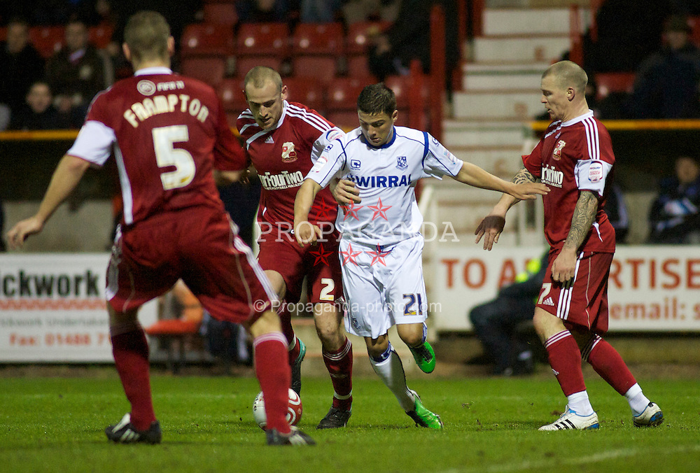 SWINDON, ENGLAND - Tuesday, January 25, 2011: Tranmere Rovers' Dale Jennings runs at the Swindon Town defence during the Football League One match at the County Ground. (Photo by Gareth Davies/Propaganda)