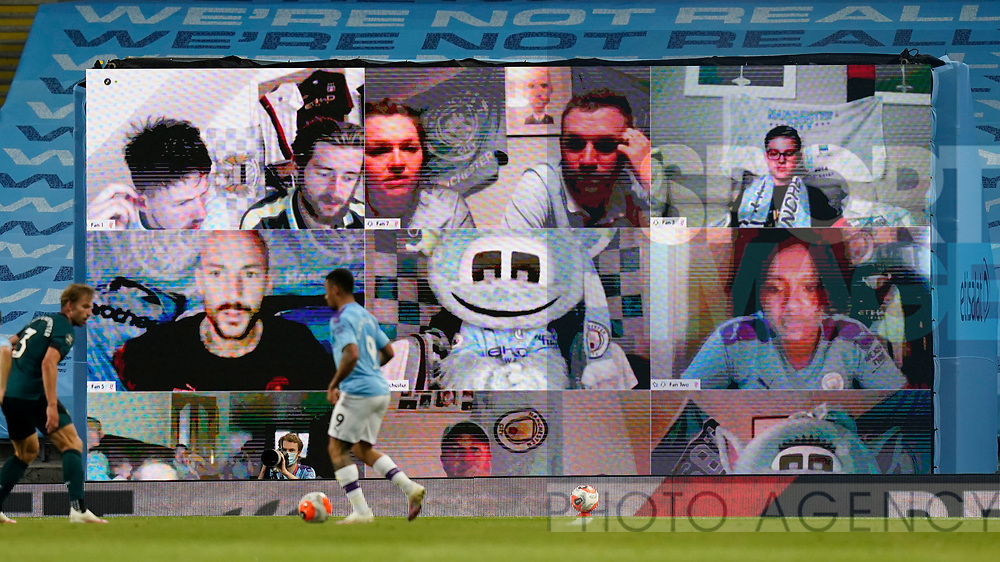 Fans watching the game are shown on a giant screen during the Premier League match at the Etihad Stadium, Manchester. Picture date: 22nd February 2020. Picture credit should read: Andrew Yates/Sportimage