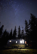 Nighttime camping under the stars in a recreational vehicle at Crater Lake National Park, Oregon.