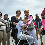 OXON HILL, MD-OCT20: Lakisha Jenkins, the mother of  Keyshaun Mason,14, who was stabbed to death by Jenkins' live-in boyfriend, cries at a gathering for the press outside Potomac High School in Oxon Hill, MD, October 20, 2105. During a domestic dispute, Lakisha Jenkins, was barricaded in the master bedroom of her home by her live-in boyfriend, 48-year-old Sean Crawford. Crawford was armed with a kitchen knife. Keyshaun Mason, 14, and his 18-year-old brother attempted to enter the master bedroom to ask Crawford to leave their home. According to the documents, Crawford then stabbed Keyshaun in the chest. Both teens were taken to a local hospital where Keyshaun was pronounced dead. His brother was treated at the hospital and released. (Photo by Evelyn Hockstein/For The Washington Post)