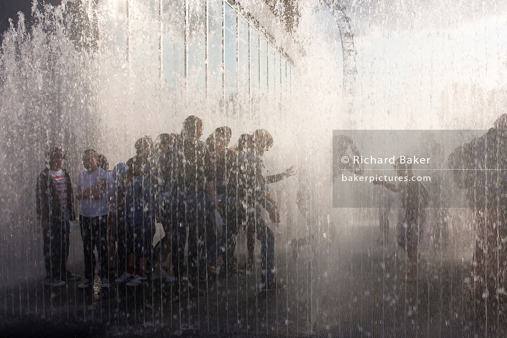 Londoners get wet in a splash experience at the South Bank during the free Mayor's Thames Festival celebration along the capital's river.