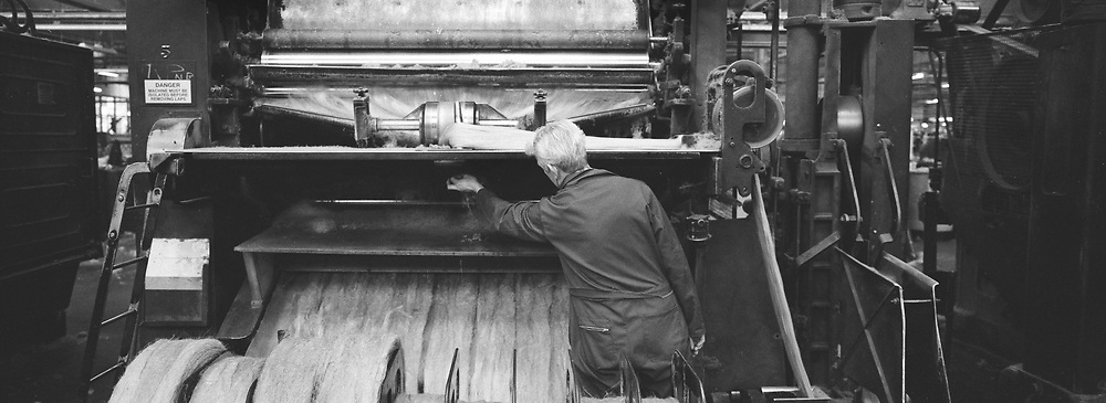 A worker checking a machine at Tay Spinners mill in Dundee, Scotland. This factory was the last jute spinning mill in Europe when it closed for the final time in 1998. The city of Dundee had been famous throughout history for the three 'Js' - jute, jam and journalism.