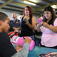 ORLANDO, FL - Felix Verdejo signs autographs for his fans during a media day workout at the Orlando Sports Martial Arts Academy on October 2, 2014 in Orlando, Florida. (Photo by Alex Menendez/Getty Images) *** Local Caption *** Felix Verdejo