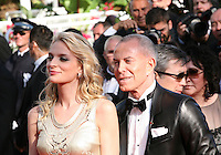 Sarah Marshall and Jean Claude Jitrois at the gala screening of the film Moonrise Kingdom at the 65th Cannes Film Festival. Wednesday 16th May 2012, the red carpet at Palais Des Festivals in Cannes, France.