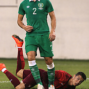 Cristiano Ronaldo, Portugal, goes down after a challenge by Stephen Kelly, Ireland, during the Portugal V Ireland International Friendly match in preparation for the 2014 FIFA World Cup in Brazil. MetLife Stadium, Rutherford, New Jersey, USA. 10th June 2014. Photo Tim Clayton