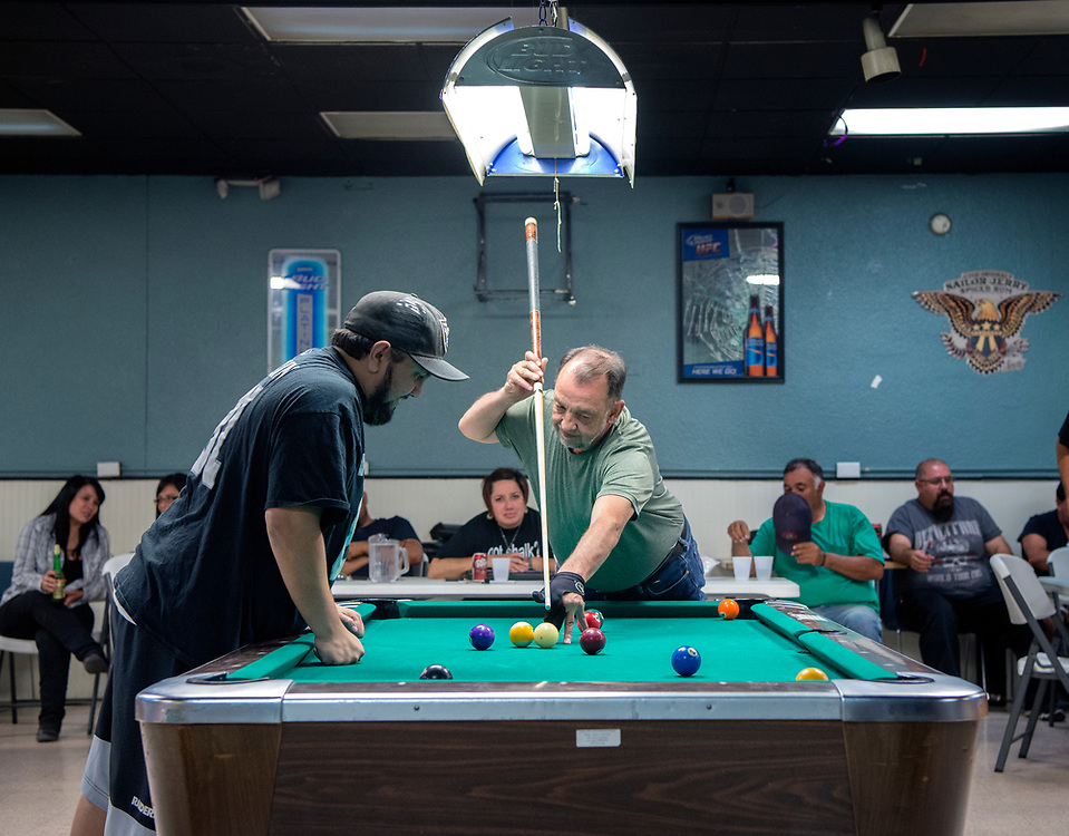em071817m/jnorth/Manuel Mora, left, and Donald Quintana, both members of the Saloon Shots billards team, try a tough shot during a game of 9 ball at the Faternal Order of the Eagle club, in Las Vegas, Tuesday July 18, 2017. The billards team is headed to Las Vegas Nevada to compete nationally. (Eddie Moore/Albuquerque Journal)