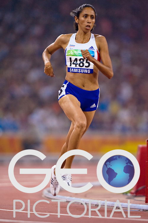 "Assia EL'HANNOUNI of France competes in the women's T13 1500m race during the Beijing 2008 Paralympic Games in the National ""Bird's Nest"" Stadium on the 8th September 2008;"