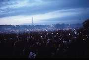 People at the stone circle, as the sunset, Glastonbury Festival, UK 1998