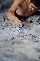 Rock climber struggling on cliff