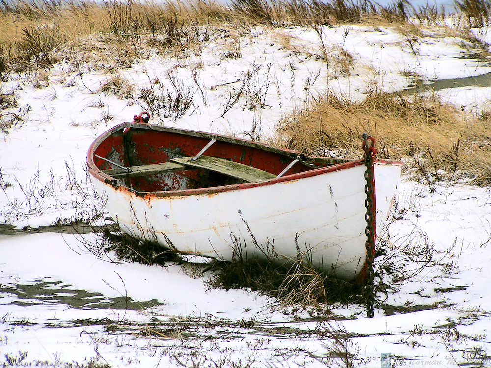 This long-beached boat sits at Fort Worden in Port Townsend, Washington.  A dusting of snow really makes its day