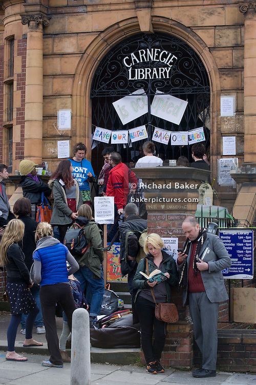 Campaigners protesting the closure by Lambeth council of Carnegie Library in Herne Hill, south London as protesters remain inside the premises on day 3 of its occupation, 3rd April 2016. The angry local community in the south London borough have occupied their important resource for learning and social hub for the weekend. After a long campaign by locals, Lambeth have gone ahead and closed the library's doors for the last time because they say, cuts to their budget mean millions must be saved. A gym will replace the working library and while some of the 20,000 books on shelves will remain, no librarians will be present to administer it.