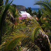 Las Alamandas, south of Puerto Vallarta, Mexico: Pink turret peaking through the palm fronds of this luxury resort on the west coast of Mexico south of Puerto Vallarta with excellent food. (Photo:Ann Summa).