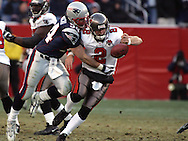 New England Patriot Linebacker Tedy Bruschi forces Tampa Bay's Quarterback Chris Simms to fumble the football.  New England hammered Tampa Bay's offensive all game with intense pressure in an impressive 28-0 victory at Gillette Stadium, Foxboro, MA