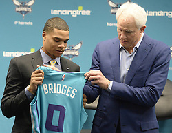 June 22, 2018 - Charlotte, NC, USA - Charlotte Hornets draft pick Miles Bridges hold up his jersey with President of Basketball Operations & General Manager Mitch Kupchak during an introductory news conference at Spectrum Center in Charlotte, N.C., on Friday, June 22, 2018. (Credit Image: © David T. Foster Iii/TNS via ZUMA Wire)