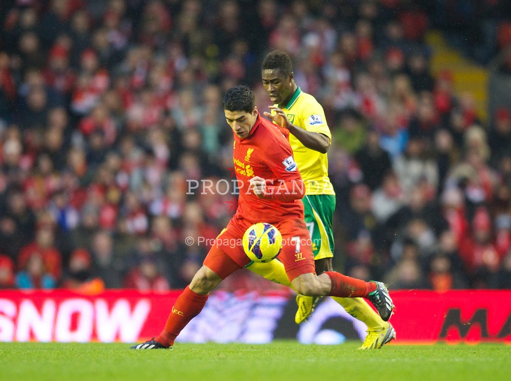LIVERPOOL, ENGLAND - Saturday, January 19, 2013: Liverpool's Luis Alberto Suarez Diaz in action against Norwich City's Alexander Tettey during the Premiership match at Anfield. (Pic by David Rawcliffe/Propaganda)