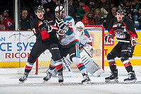 KELOWNA, CANADA - JANUARY 3: Aaron Macklin #17 of Prince George Cougars checks Devante Stephens #21 of Kelowna Rockets on January 3, 2015 at Prospera Place in Kelowna, British Columbia, Canada.  (Photo by Marissa Baecker/Shoot the Breeze)  *** Local Caption *** Aaron Macklin; Devante Stephens;