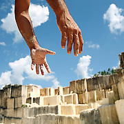 A man works at a cooperative Quarry in Cuba. Man-hours and sweat can be traded for the stone, which this man was transporting to a neighboring village to use as raw building material for structures. Cubans can donate their time to cut bricks from the stone, and are allowed to take a portion of the product home in reparation. ltqmb CUBA: BUILDING HANDS