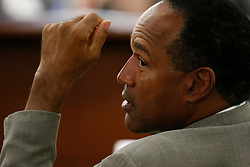 O.J. Simpson reacts in court during  his arraignment on 11 felony charges in Las Vegas. Simpson's charges range from assault with a deadly weapon to robbery and kidnapping. (Credit Image: