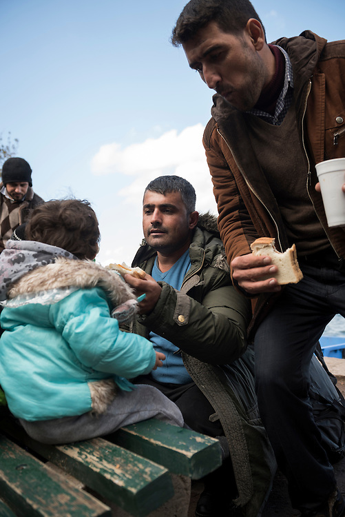 Mustafa, age 34, feeds his daughter Gala, who is almost two, a sandwich made by volunteers. They are Kurds from Qamishli, Syria, and had arrived here on the Greek island of Lesbos by boat from Turkey earlier in the day.