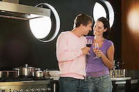 Romantic Couple Drinking Wine in Kitchen