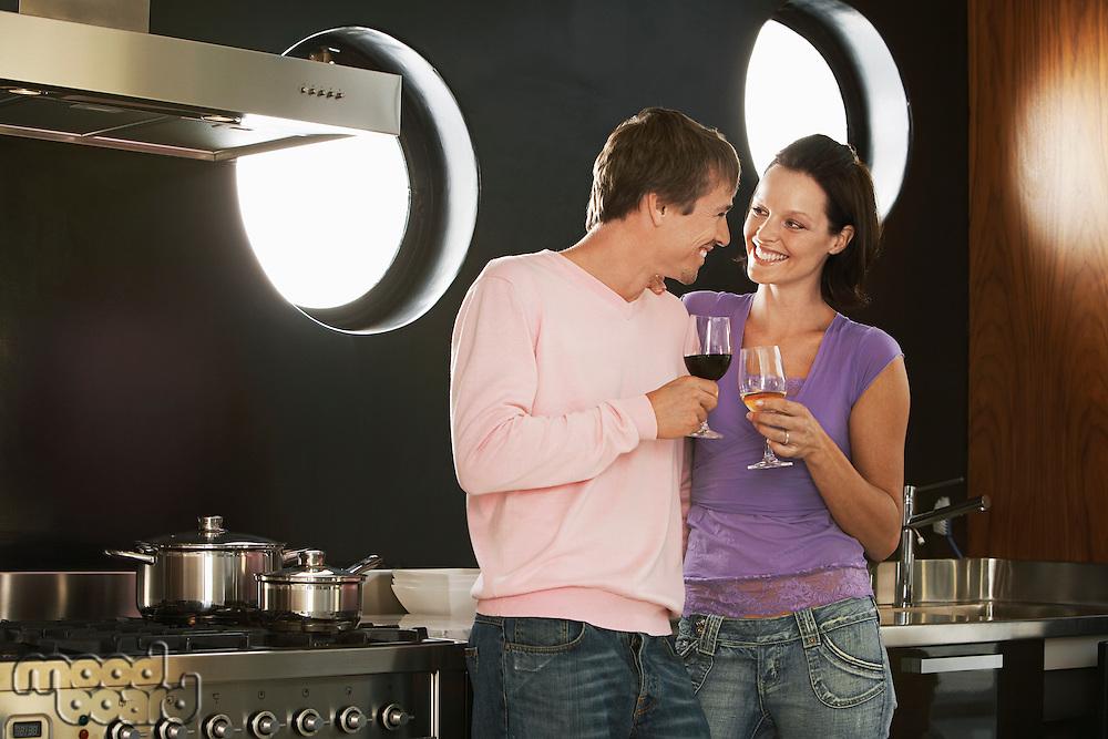 Romantic Couple Drinking Wine in Kitchen