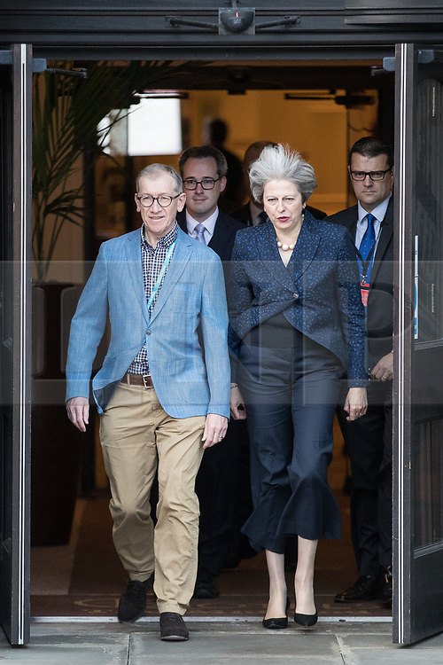 © Licensed to London News Pictures . 02/10/2017. Manchester, UK. Prime Minister THERESA MAY and husband PHILIP MAY leave the Midland Hotel at the start of the second day of the Conservative Party Conference at the Manchester Central Convention Centre . Photo credit: Joel Goodman/LNP