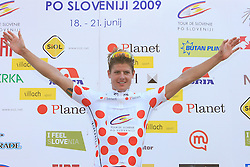 Winner Jakob Fuglsang of Denmark (Team Saxo Bank) in polka dot jersey as the best cyclist in mountain classification at the flower ceremony at 1st stage of Tour de Slovenie 2009 from Koper (SLO) to Villach (AUT),  229 km, on June 18 2009, in Koper, Slovenia. (Photo by Vid Ponikvar / Sportida)