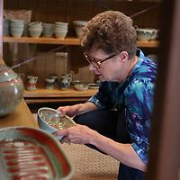 Carla Falkner browses pottery Saturday at the Gumtree Festival