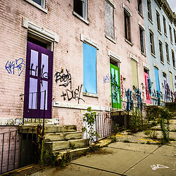 """Cincinnati Glencoe-Auburn Row Houses photo. Known as """"The Hole"""" the complex was abandoned and in very poor condition.  The Glencoe-Auburn Place Row Houses were built in the late 1800's and were listed on the U.S. National Register of Historic Places. Glencoe-Auburn Place was demolished in March 2013."""