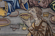 Detail of an apostle drinking wine, on the Tapestry of the Last Supper, 15th century, by an unknown artist, in linen, wool, silk and gold thread, in the collection of the Museum of Tortosa Cathedral, in the Cathedral of St Mary, designed by Benito Dalguayre in Catalan Gothic style and begun 1347 on the site of a Romanesque cathedral, consecrated 1447 and completed in 1757, Tortosa, Catalonia, Spain. Picture by Manuel Cohen