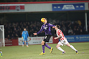 Morecambes Ryan Edwards & Cheltenhams Jack Dunn battle for the ball during the Sky Bet League 2 match between Cheltenham Town and Morecambe at Whaddon Road, Cheltenham, England on 16 January 2015. Photo by Shane Healey.