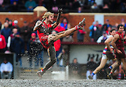 North Adelaide footballer Andrew McIntyre makes a kick out of a muddy centre square during a South Australian National Football League match against Central Districts.<br /> <br /> Winner of Best Action Photograph - SANFL Media Awards 2008<br /> Best Sports Photograph - South Australian Media Awards 2009